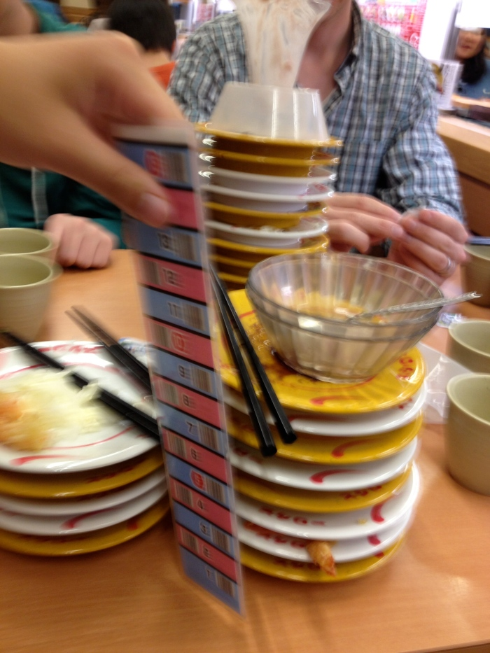 Conveyor belt sushi - after you eat the waitress comes and measures how many plates you had and charges you.